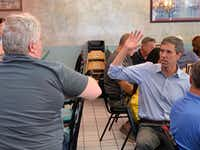 Democratic presidential candidate Beto O'Rourke talks to a potential voter at John's Family Grill in Mount Clemens, Mich.(Gromer Jeffers Jr./Staff)