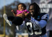 Dallas Cowboys free safety Kavon Frazier (35) plays with his daughter, Kali Frazier, 15 months, after an afternoon practice at training camp in Oxnard, Calif., on July 29, 2019.(Ashley Landis/Staff Photographer)