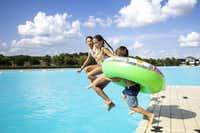 Michiko Steinhilper, 10, looks at her sister, Sachiko Steinhilper, 13, as they jump off the dock with their bother, Iokua Steinhilper, 6, at the Crystal Lagoon on Windsong Ranch in Prosper on July 2, 2019.(Shaban Athuman/Staff Photographer)