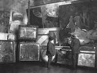 Claude Monet (left) in his second studio in Giverny with the Duc de Trévise, c. 1920. Musée du Louvre, Paris. The Kimbell's <i>Weeping Willow</i>&nbsp;is shown in its original frame, second from left, the bottom row.(Kimbell Art Museum)