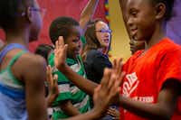 Theodore Penn, 10 (center) and Aaliyah Wills, 9 (right), participate in a pantomime exercise during a theatre class presented by Humanities of Tomorrow at the Boys and Girls Club in Frisco, Texas, on Wednesday, July 31, 2019. The Humanities of Tomorrow program was founded by high school students to offer an arts and humanities curriculum to children during one-week programs. (Lynda M. Gonzalez/Staff Photographer)