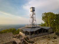 The Firetower restaurant is nearly a 1.5-mile hike from the Blackberry Mountain resort — uphill all the way. But guests who aren't inclined to hike can get a lift in a golf cart or one of the vehicles from the resort's Lexus fleet.(Blackberry Mountain)