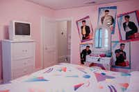 Posters of the beloved boy band New Kids on the Block surround the vanity in one of the bedrooms at The Slater.<br>(Nicholas Leitzinger)