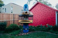 A piece of vintage McDonald's play equipment stands out in the backyard of The Slater.<br>(Nicholas Leitzinger)