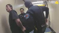 Justin Brafford is shown being arrested by police after his behavior forced a Dallas-bound Southwest Airlines flight to make an emergency landing last October in Albuquerque.(KRQE, CBS-13)