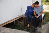 Sanjuana Galicia, left, leans in to her son Francisco's shoulder as they talk with each other outside their home in Edinburg on July 27, 2019.(Ryan Michalesko/Staff Photographer)