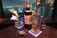 At TwentyEight, the stylish 28th-floor bar at the posh Conrad Tokyo, highballs are served with grated lemon rind, which you can add to your liking to enhance the drink's aromatic effect.  (Liza Weisstuch/The Washington Post)