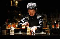 At Apollo Bar in Tokyo, Hidenori Komatsu's highball preparation involves dancelike grace and precision, under a spotlight, with Tom Waits songs playing on repeat. (Liza Weisstuch/The Washington Post)
