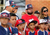 Danny Latin, Ray Garcia, and Jimmy Villatoro of El Paso listen during the candlelight vigil at The Sportspark in El Paso, Texas on Sunday, August 4, 2019. (Vernon Bryant/Staff Photographer)