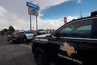 Police and state troopers keep watch outside the Cielo Vista Mall Walmart (background) where a shooting left 20 people dead in El Paso, Texas, on August 4, 2019. (MARK RALSTON/AFP/Getty Images)