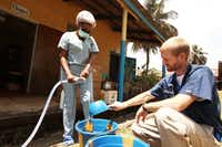Dr. Kent Brantly, an American who contracted Ebola, works at an Ebola isolation ward at a mission hospital outside of Monrovia, Liberia, in this undated photo from Samaritan's Purse, an evangelical Christian humanitarian relief organization.(Samaritan's Purse/Getty Images)