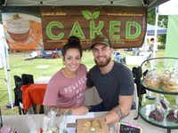 Nicole Esposito brought her Caked Bakery vegan baked goods, including strawberry donuts and lemon-poppyseed scones, to the Denton Community Market for the first time Aug. 3. Wyatt Quintero gave her a hand.(Kim Pierce)