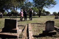 Consul General of France Pierre Grandjouan, center, tours  La Reunion Cemetery with historical researcher Frances James, left, and Christopher Thevenet, a descendant of La Reunion colonists, on Nov. 4, 2010.(Ben Torres/Special Contributor)