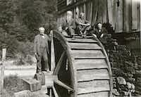 (From left) Thomas Edison, naturalist John Burroughs, Henry Ford and Harvey Firestone pose on a water mill wheel.(Collections of The Henry Ford)