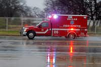 A Dallas Fire-Rescue ambulance headed to a call on a cold rainy morning in Dallas on Jan. 2, 2019.(File Photo/Staff)