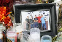 Photo of Javier Amir Rodriguez (second from left) left near a cross with his name on it at a makeshift memorial for victims at a shopping complex near the Walmart of a mass shooting in El Paso, Texas on Tuesday, August 6, 2019. (Vernon Bryant/Staff Photographer)