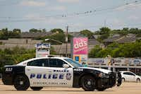 A Dallas Police vehicle sits in one of the parking lots at the Forest-Audelia intersection.<div><br></div>(Smiley N. Pool/Staff Photographer)