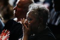 Marsha Jackson wipes a tear from her after as she listens to speakers during a press conference concerning Shingle Mountain at Dallas City Hall last March.(Ryan Michalesko/Staff Photographer)