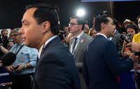 Democratic presidential hopeful former Julian Castro (R) and his twin brother, Rep. Joaquin Castro (L), speak with the press in the Spin Room after participating in the first Democratic primary debate of the 2020 presidential campaign.(SAUL LOEB/AFP/Getty Images)