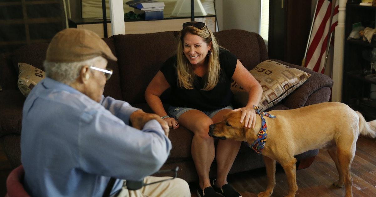 Puppy love: Volunteers bring food to dogs, cheer to elderly owners