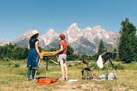 Visitors find an iconic scene to paint with the Grand Tetons near Jackson Hole, Wyo.(Visit Jackson Hole)