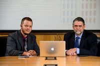 Southern Methodist University professors Eric Larson (left) and Mitchell Thornton sit in a conference room similar to the one used in their experiment(Guy Rogers III/SMU)
