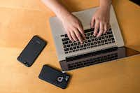 The researchers tested smartphones with their app on several types of keyboards and tables. While the phones in this image are close to the laptop, the study looked at the ability for smartphones to determine typing from as far as 5 to 6 feet away.(Guy Rogers III/SMU)