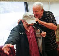 """<p><span style=""""font-size: 1em; background-color: transparent;"""">Retired major league umpire Larry Barnett, who has visited hospitalized veterans since 1977, presents a jacket to Russell Moore, a Navy veteran, during a visit to the VA North Texas Health Care System on Thursday, Aug. 8, in Dallas.</span></p>(Ryan Michalesko/Staff Photographer)"""