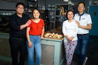 KJ Park (left) poses for a photograph with his wife, Jinny Cho, owner of Detour Doughnuts and Coffee, his mother-in-law,  Miran Han, and father-in-law Gab Kyu Cho, right, at Detour Doughnuts and Coffee in Frisco.(Shaban Athuman/Staff Photographer)