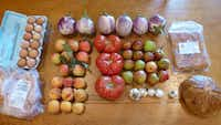 Here's the bounty I brought home from the Cowtown Farmers Market last Saturday: eggplant, apples, pears, peaches, tomatoes, garlic, pastured chicken and eggs, chicken tortilla soup (the frozen rectangle, upper right) and just below it, sourdough bread made fresh that morning.(Kim Pierce)