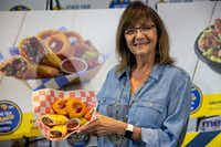 Christi Erpillo holds up Fernie's Fried Burnt End Burrito during the unveiling of the Big Tex Choice Awards. Erpillo has worked at the fair since she was a teenager.(Lynda M. Gonzalez/Staff Photographer)