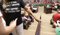 A supporter of The Turning Point rape crisis center waited Monday night to speak at a Plano City Council meeting.(Jason Janik/Special Contributor)