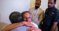 <p>Gov. Greg Abbott, shown hugging an El Paso resident after a vigil at a Catholic church there last week to honor 22 people killed in an Aug. 3 mass shooting, said Wednesday he wants a new domestic terrorism task force 'to combat these hateful acts and extremism in Texas.'</p>(<p><br></p>/Jose Angel Juarez<div>AFP/Getty Images</div>)