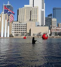 City of Dallas employee Kenneth Argusta cleans the reflecting pool at Dallas City Hall in downtown Dallas, Tuesday, February 12, 2019. (Benjamin Robinson/The Dallas Morning News)(Benjamin Robinson/Staff Photographer)