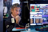 Trader John Romolo works on the floor of the New York Stock Exchange on Wednesday.(Richard Drew/AP)