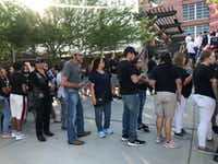 People wait to enter the ballpark shortly before the memorial got under way.(Staff photo/Alfredo Corchado)
