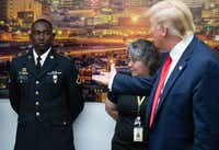 US President Donald Trump (R) gestures to PFC Glendon Oakley (L), who saved several lives during a mass shooting in Texas, during a visit to El Paso Regional Communications Center in El Paso, Texas, August 7, 2019.(SAUL LOEB/AFP/Getty Images)