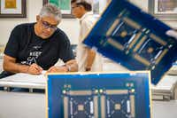 Nilesh Naik, CEO of Eagle Circuits, works with employees at the company's facility on Aug. 2, 2019, in Dallas.(Smiley N. Pool/Staff Photographer)