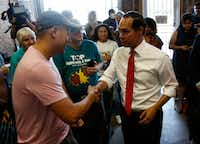 Democratic presidential hopeful Secretary Julian Castro greeted audience members before speaking to  Texas Working Families Party members during a candidate forum at the the Village Bridge Center in Dallas on Thursday.(Brian Elledge/Staff Photographer)