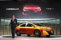 DETROIT, MI - JANUARY 14:  Bill Fey, group vice president at Toyota, introduces the Corolla Furia Concept car at the North American International Auto Show on January 14, 2013 in Detroit, Michigan. The auto show will be open to the public January 19-27.  (Photo by Scott Olson/Getty Images)Scott Olson - Getty Images