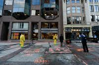 BOSTON, MA - APRIL 22:  The Boston Fire Department Hazardous Materials team clean the blast site near the Boston Marathon finish line one week after the FBI handed over Boylston street back to the city on April 22, 2013 in Boston, Massachusetts. A manhunt ended for Dzhokhar A. Tsarnaev, 19, a suspect in the Boston Marathon bombing after he was apprehended on a boat parked on a residential property in Watertown, Massachusetts. His brother Tamerlan Tsarnaev, 26, the other suspect, was shot and killed after a car chase and shootout with police. The bombing, on April 15 at the finish line of the marathon, killed three people and wounded at least 170.  (Photo by Kevork Djansezian/Getty Images) ***BESTPIX***Kevork Djansezian - Getty Images
