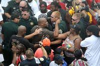 Deputies try to maintain calm after a shouting match erupts into pushing as people wait for a verdict in the George Zimmerman trial outside the Seminole County Criminal Justice Center.Joe Burbank / Orlando Sentinel