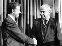 """President Jimmy Carter (left) shakes hands with Ambassador Robert Strauss after Carter named Strauss to be a special Middle East negotiator to carry out """"crucial, important"""" post Egyptian-Israeli treaty talks on Palestinian autonomy at the White House April 24.( Ronald Bennett  -  UPI )"""