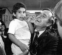 GOP presidential hopeful George H.W. Bush shares a joyous moment with his grandson, George P. Bush, 4, at the Houston headquarters of George Bush for President.