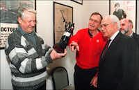 U.S. President George Bush (c) shown in this file picture dated 01 February 1992 in Camp David, Maryland, points to a pair of Texas cowboy boots he gave to Russian President Boris Yeltsin (l) on his 61st birthday while U.S. Ambassador to Russia Robert Strauss (r) looks on. The boots are decorated with metal plates representing the maps and flags of the U.S. and Russia.( DAVID VALDEZ  -  AFP/Getty Images )