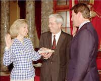 Ray Hutchison held the Bible as his wife, Kay Bailey Hutchison, was sworn in as Texas' first female senator by Vice President Al Gore. The couple met when they both were serving in the Texas Legislature in the 1970s.(File 1993 - The Associated Press)