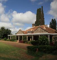 "Lush landscaped grounds surround the Karen Blixen Museum near Nairobi, Kenya. The bungalow where the famed author once lived with her husband was dubbed Mbogani, a Kiswahili word meaning ""house in the forest."""