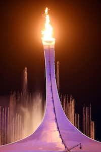 The Olympic flame was lit outside Fisht Olympic Stadium at Friday's opening ceremony in Sochi, Russia, by figure skater Irina Rodnina and former hockey goaltender Vladislav Tretiak.