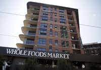 The Gables McKinney  apartments sit above Whole Foods Market in Uptown Dallas.(G.J. McCarthy - Staff photographer)