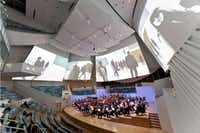 Big acoustical reflectors above the stage can double as projection surfaces.